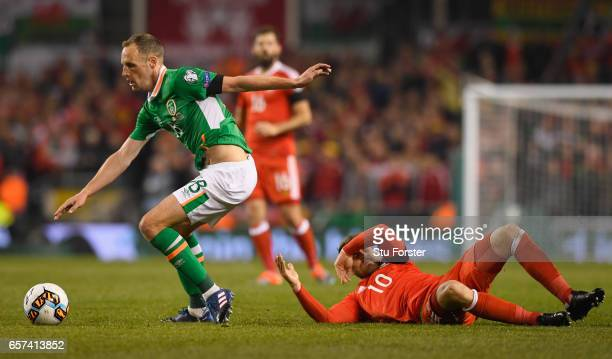 David Meyler of the Republic of Ireland shrugs off Aaron Ramsey of Wales during the FIFA 2018 World Cup Qualifier between Republic of Ireland and...