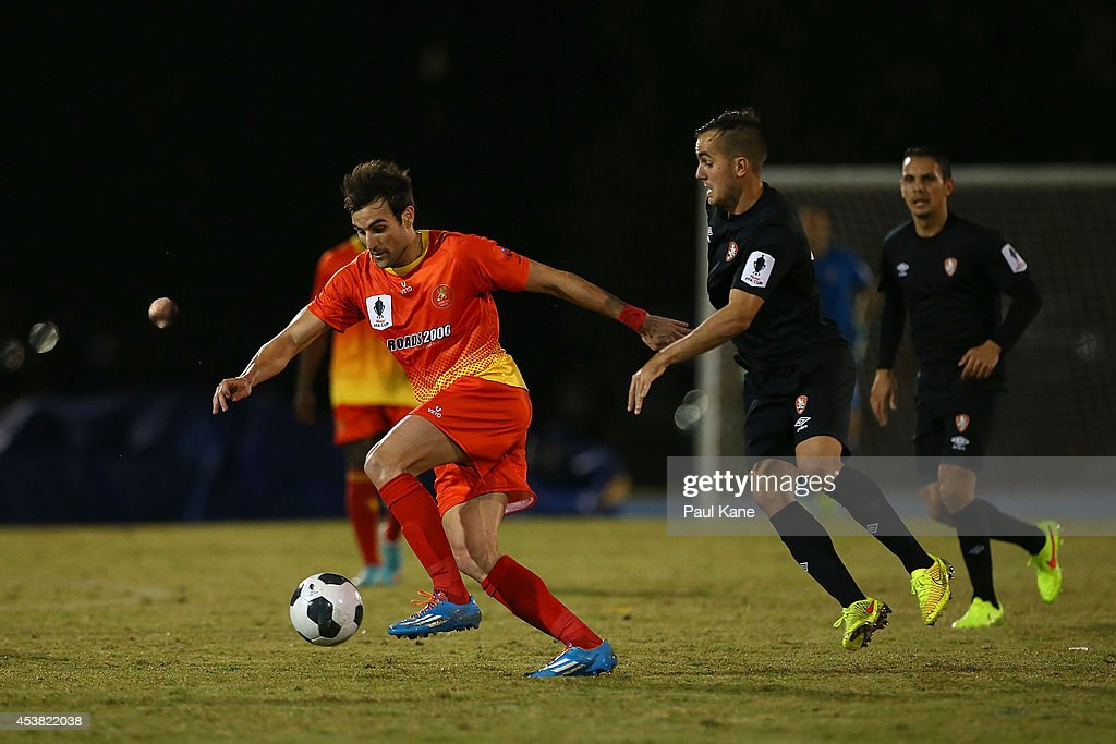 David Micevski of the Lions controls the ball against Steven Lustica of the Roar during the FFA Cup match between the Stirling Lions and the Brisbane Roar at Western Australia Athletics Stadium on August 19, 2014 in Perth, Australia.