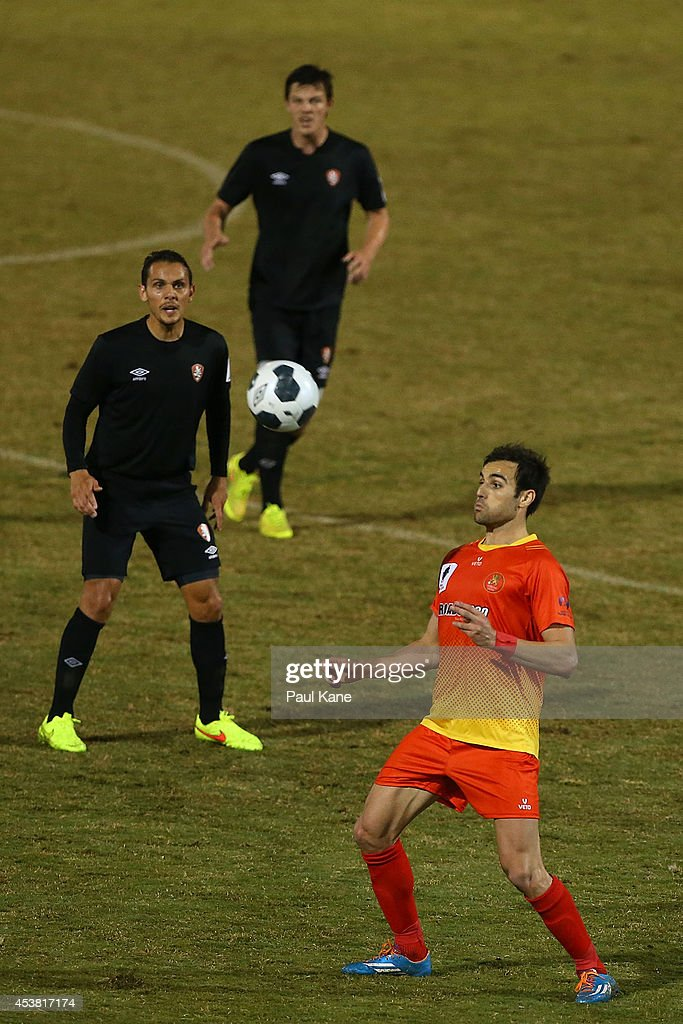 David Micevski of the Lions traps the ball during the FFA Cup match between the Stirling Lions and the Brisbane Roar at Western Australia Athletics Stadium on August 19, 2014 in Perth, Australia.
