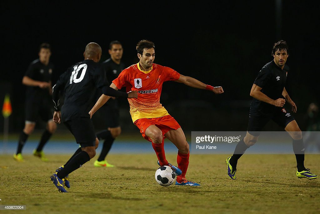 David Micevski of the Lionsis challenged by Henrique De Silva of the Roar during the FFA Cup match between the Stirling Lions and the Brisbane Roar at Western Australia Athletics Stadium on August 19, 2014 in Perth, Australia.