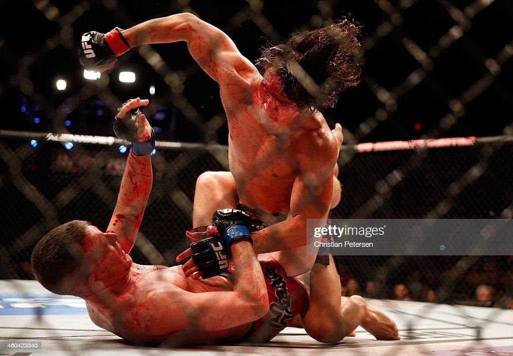 David Michaud (top) punches Garett Whiteley (bottom left) during the UFC Fight Night event at the at U.S. Airways Center on December 13, 2014 in Phoenix, Arizona.