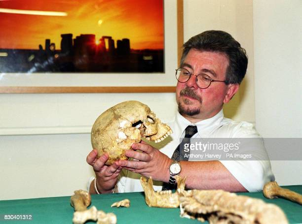 David Miles English Heritage's Chief Archaeologist handles the skull of a 2000yearold human skeleton at English Heritage's Headquarters in central...