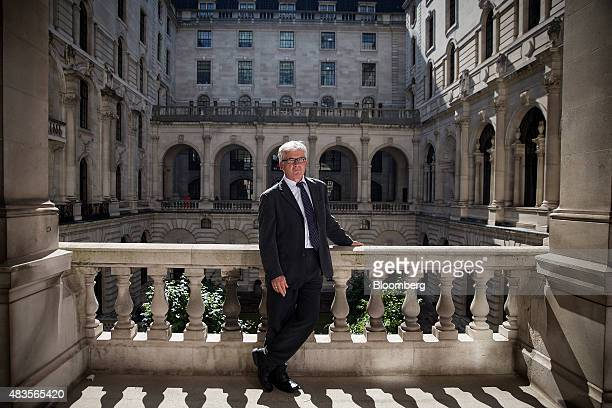 David Miles monetary policy committee member at the Bank of England poses for a photograph following an interview at the BOE in the City of London UK...