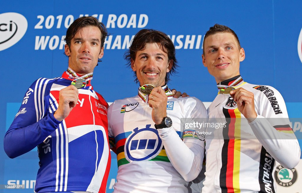 <a gi-track='captionPersonalityLinkClicked' href=/galleries/search?phrase=David+Millar+-+Cyclist&family=editorial&specificpeople=4394499 ng-click='$event.stopPropagation()'>David Millar</a> of Great Britain, <a gi-track='captionPersonalityLinkClicked' href=/galleries/search?phrase=Fabian+Cancellara&family=editorial&specificpeople=573515 ng-click='$event.stopPropagation()'>Fabian Cancellara</a> of Switzerland and Tony Martin of Germany hold their medals aloft during the medal presentation for the Men's Elite Time Trial on day two of the UCI Road World Championships on September 30, 2010 in Geelong, Australia.