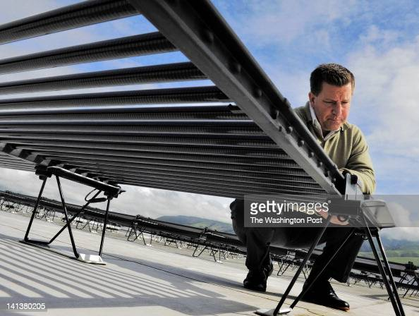 David Miller Director of Corporate Communications on the roof with solar collecting tubes by Solyndra a solar energy technology company visited by...