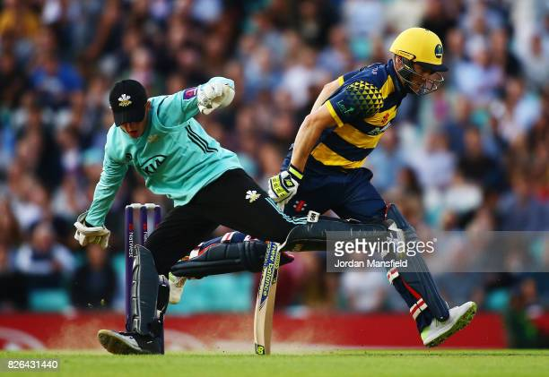 David Miller of Glamorgan lunges to make his ground as Ollie Pope of Surrey attempts to run him out during the NatWest T20 Blast match between Surrey...