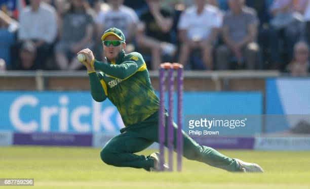 David Miller of South Africa catches Jos Buttler of England during the 1st Royal London oneday international cricket match between England and South...