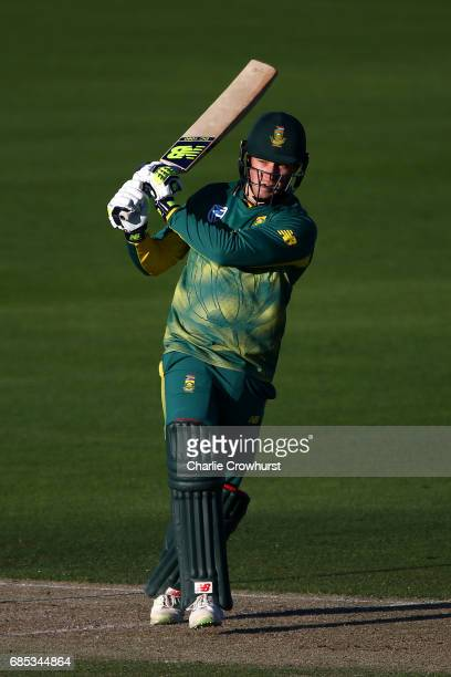 David Miller of South Africa hits out while Sussex wicket keeper Michael Burgess looks on during the Tour Match between Sussex and South Africa at...