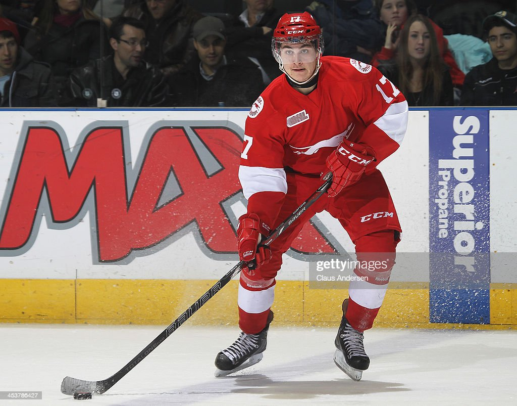 David Miller #17 of the Sault Ste. Marie Greyhounds skates with the puck against the London Knights during an OHL game at the Budweiser Gardens on December 4, 2013 in London, Ontario, Canada. The Knights defeated the Greyhounds 3-2.