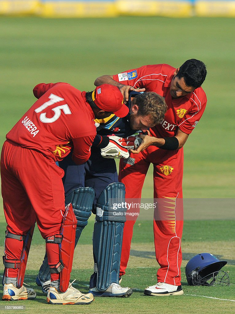 David Miller of Yorkshire receives attention after being struck by Umar Gul of Uva during the Karbonn Smart CLT20 pre-tournament Qualifying Stage match between Yorkshire (England) and Uva Next (Sri Lanka) at Bidvest Wanderers Stadium on October 09, 2012 in Johannesburg, South Africa.