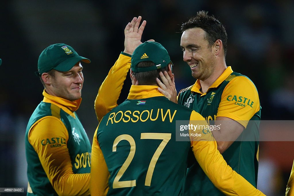 David Miller, Rilee Rossouw and Kyle Abbott of South Africa celebrates taking the wicket of Kevin O'Brien of Ireland during the 2015 ICC Cricket World Cup match between South Africa and Ireland at Manuka Oval on March 3, 2015 in Canberra, Australia.