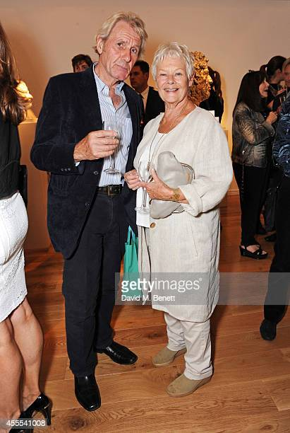 David Mills and Dame Judi Dench attend a private view for Nicole Farhi's debut exhibition of sculptures 'From The Neck Up' at Bowman Sculpture on...
