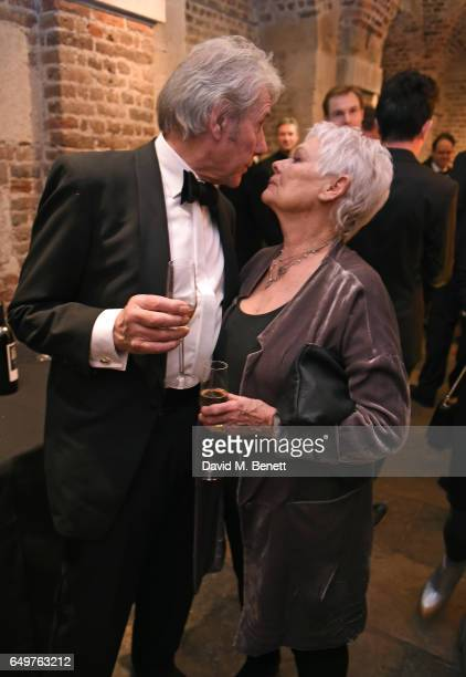 David Mills and Dame Judi Dench attend the St MartinintheFields Gala Dinner and auction of Alexander Newley portraits on March 8 2017 in London...