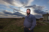 David Milne stands beside his home at Hermit point on the Menie Estate which he is refusing to sell to the Trump organisation on October 28 2009 in...