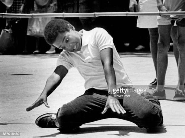 David Milton 13 had no trouble winning a limbo contest at the May D F Plaza Thur It was a promotion for a new movie called 'Club Paradise' He took...