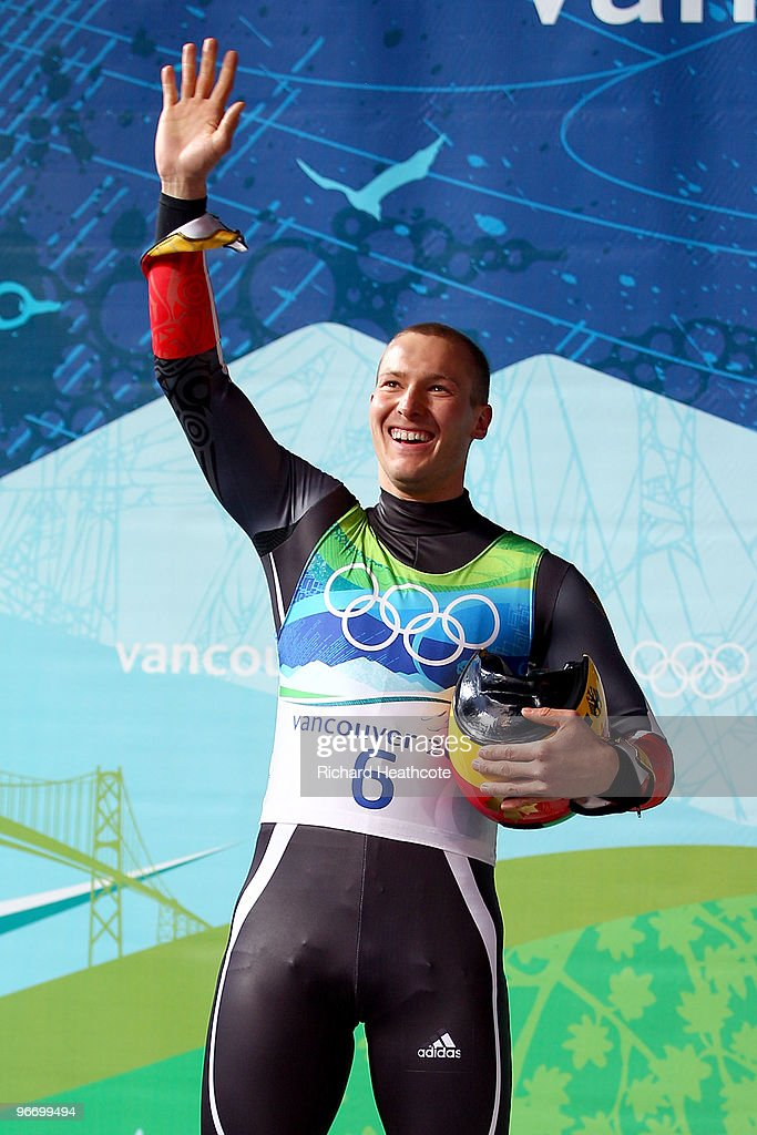 David Moeller of Germany celebrates on the podium after winning the silver medal after the final run of the men's luge singles final on day 3 of the 2010 Winter Olympics at Whistler Sliding Centre on February 14, 2010 in Whistler, Canada.