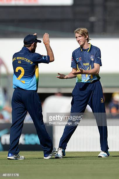 David Moody of Australia celebrates after taking the wicket of Joe Root of England during the tour match between the Prime Ministers XI and England...