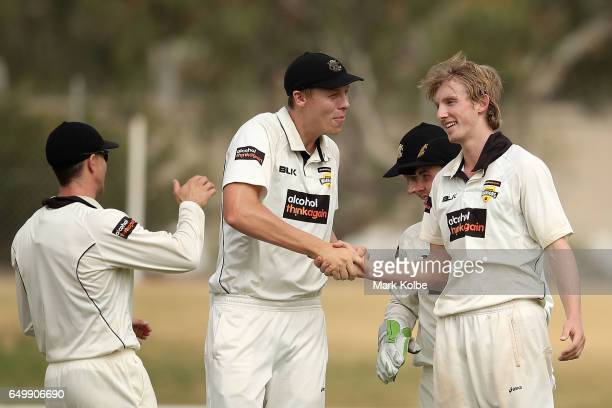 David Moody of the Warriors celebrates with his team mates after taking the wicket of Jon Holland of the Bushrangers during the Sheffield Shield...
