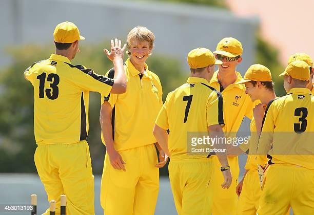 David Moody of Western Australia celebrates with his teammates after taking a wicket during the U19 Championship match between Western Australia and...
