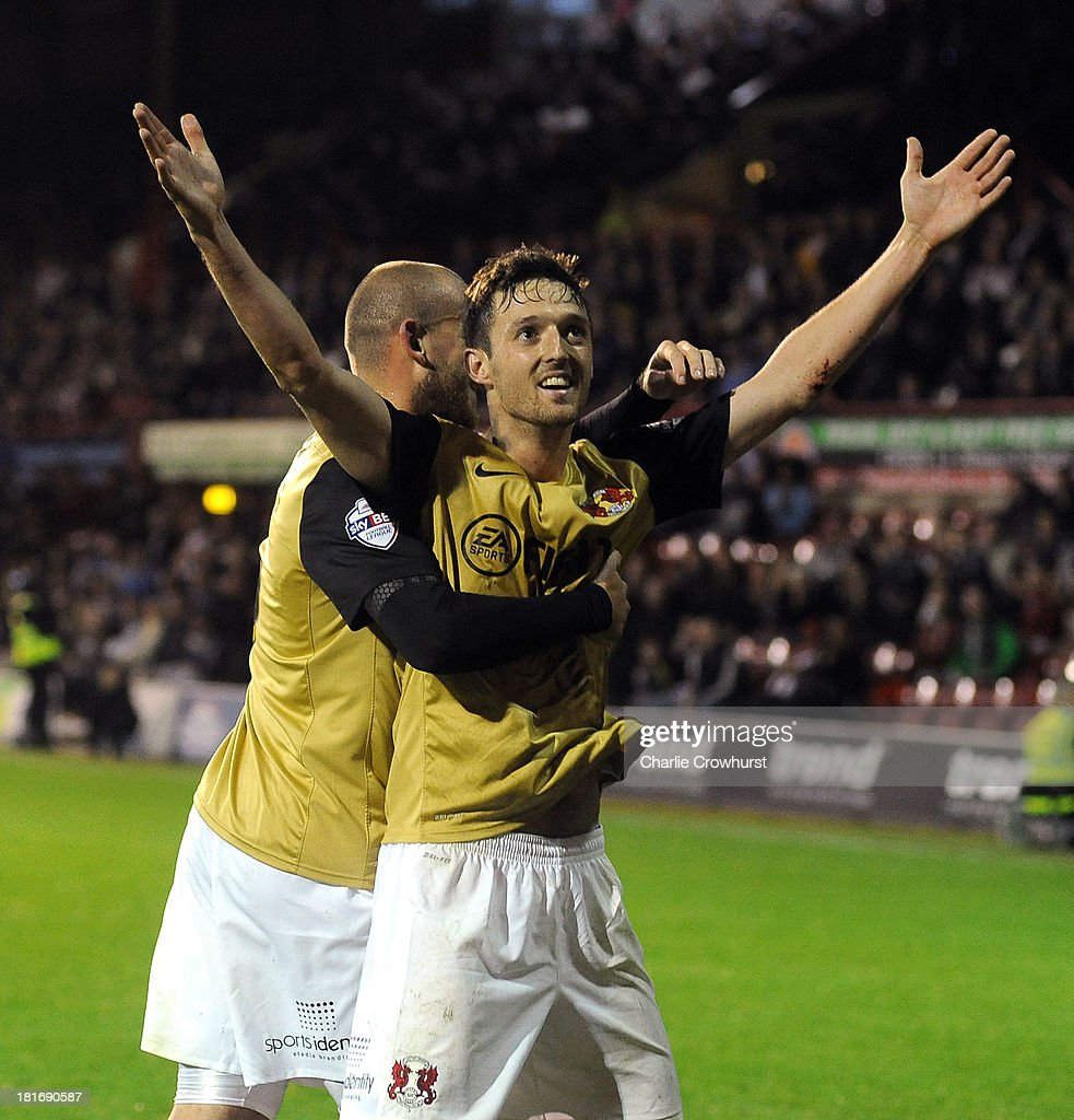 David Mooney of Leyton Orient celebrates with Scott Cuthbert after he scores the first goal of the game from the penalty spot during the Sky Bet League Once match between Brentford and Leyton Orient at Griffin Park on September 23, 2013 in Brentford, England.
