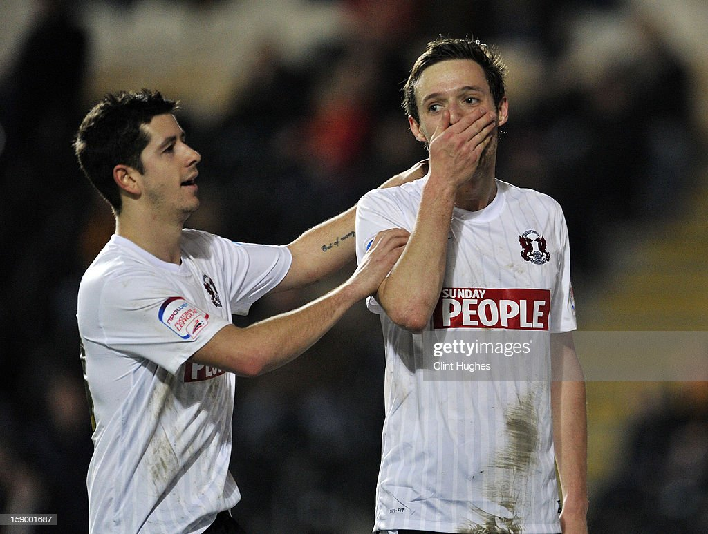 David Mooney (right) of Leyton Orient celebrates with team-mate Lloyd James after he scored the first goal of the game for his side during the FA Cup with Budweiser Third Round match between Hull City and Leyton Orient at the KC Stadium on January 5, 2013 in Hull, England