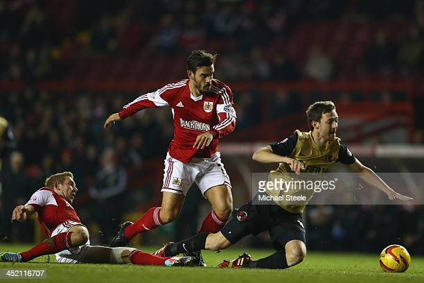 David Mooney of Leyton Orient is fouled by Marlon Pack and Scott Wagstaff of Bristol City during the Sky Bet League One match between Bristol City...