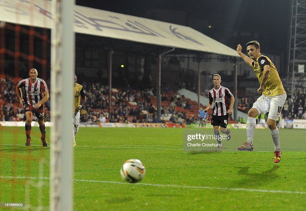 David Mooney of Leyton Orient scores the first goal of the game from the penalty spot during the Sky Bet League Once match between Brentford and Leyton Orient at Griffin Park on September 23, 2013 in Brentford, England.