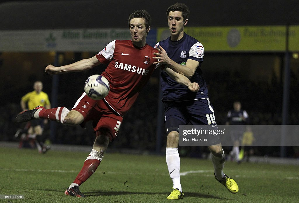 David Mooney of Leyton Orient shoots on goal ahead of Luke Prosser of Southend during the Johnstone's Paint Trophy Southern Section Final match between Southend United and Leyton Orient at the Roots Hall Stadium on February 20, 2013 in Southend, England.