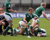 David Moore of Ireland feeds the ball out during the IRB Junior World Championships game between Ireland and Scotland on June 22 2008 at Rodney...