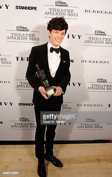 David Moorst winner of the Emerging Talent Award in partnership with Burberry poses in front of the Winners Boards at The London Evening Standard...