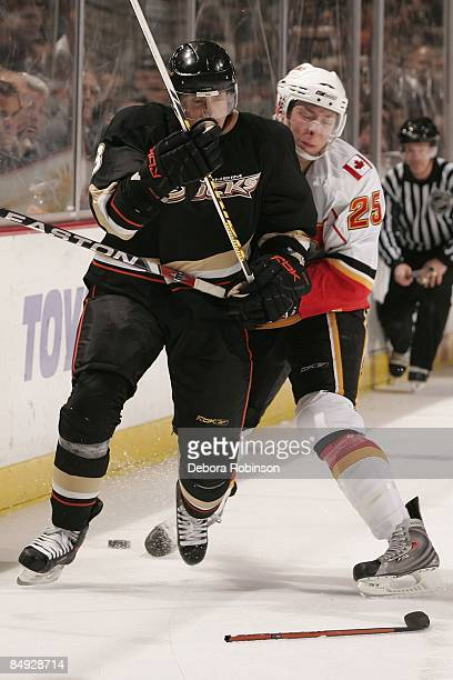 David Moss of the Calgary Flames collides into Teemu Selanne of the Anaheim Ducks during the game on February 11 2009 at Honda Center in Anaheim...