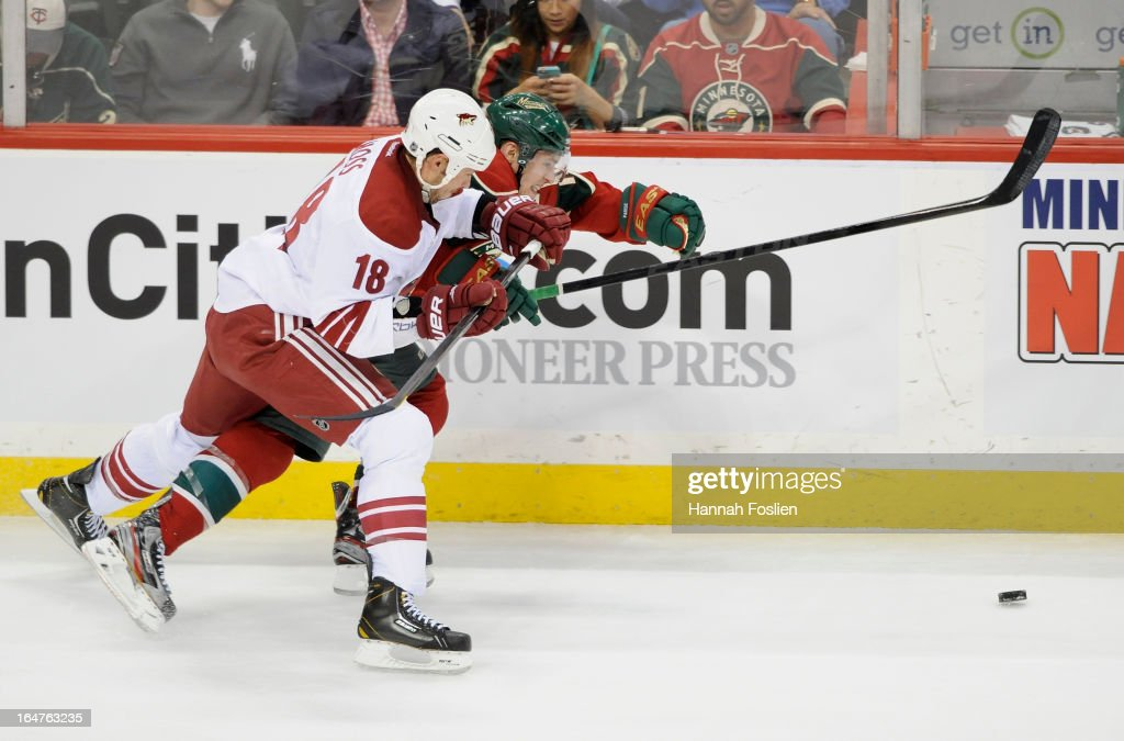 David Moss #18 of the Phoenix Coyotes and <a gi-track='captionPersonalityLinkClicked' href=/galleries/search?phrase=Zach+Parise&family=editorial&specificpeople=213606 ng-click='$event.stopPropagation()'>Zach Parise</a> #11 of the Minnesota Wild skate after the puck during the third period of the game on March 27, 2013 at Xcel Energy Center in St Paul, Minnesota. The Wild defeated the Coyotes 4-3 in overtime.