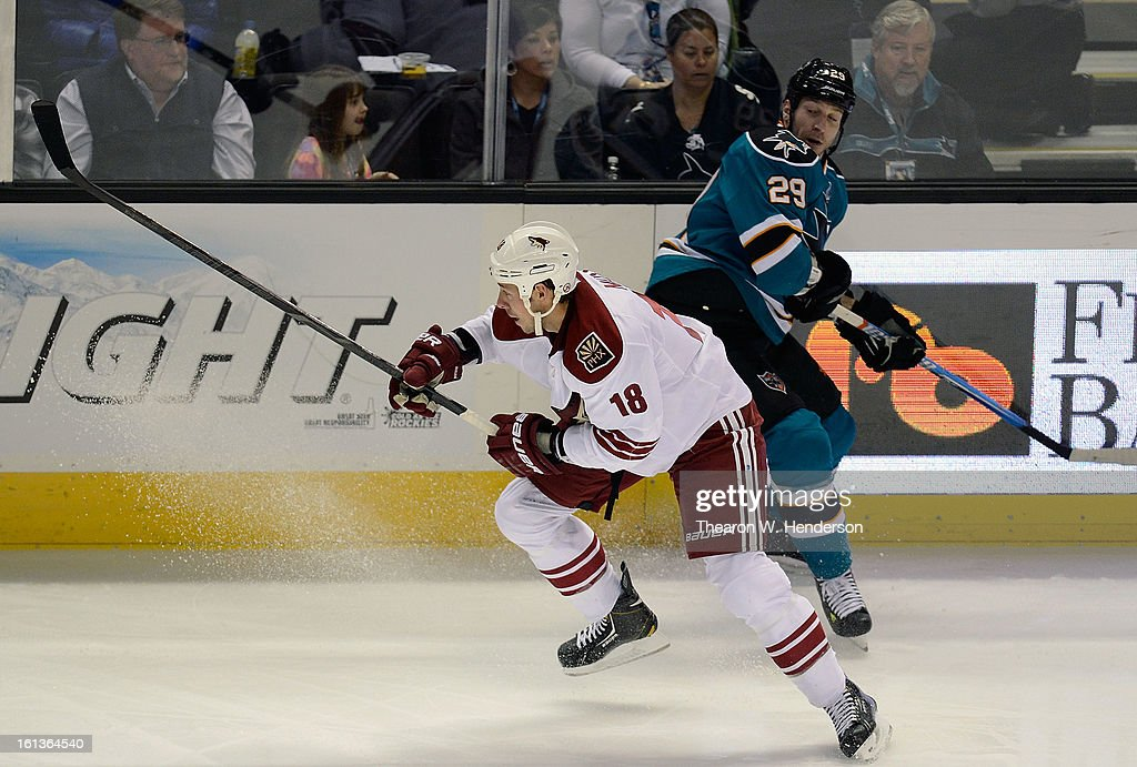David Moss #18 of the Phoenix Coyotes avoids collinding with Ryane Clowe #29 of the San Jose Sharks at HP Pavilion on February 9, 2013 in San Jose, California.