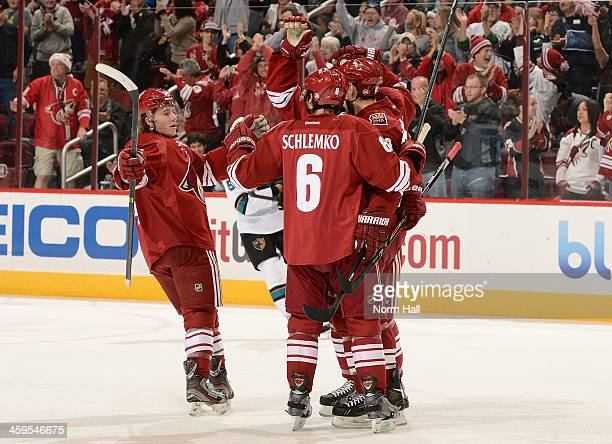 David Moss of the Phoenix Coyotes celebrates with teammates David Schlemko and Tim Kennedy after his goal against the San Jose Sharks during the...