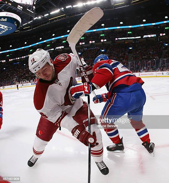 David Moss of the Phoenix Coyotes gets tangled up with Alex Galchenyuk of the Montreal Canadiens during the second period at the Bell Centre on...