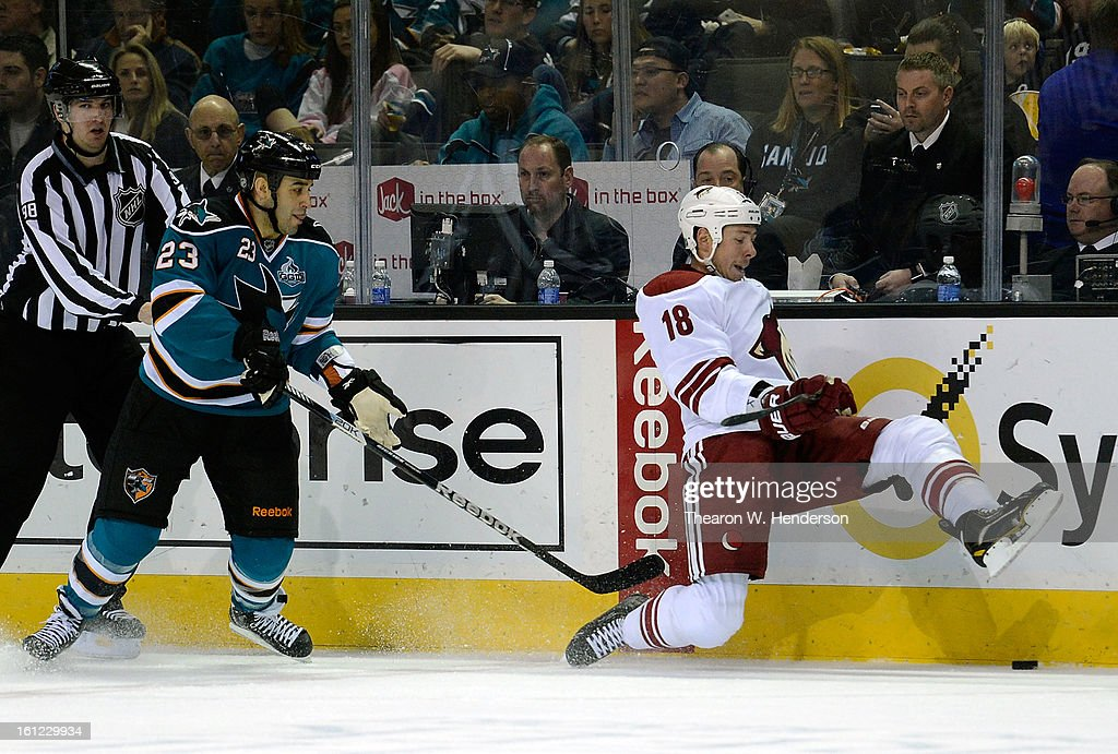 David Moss #18 of the Phoenix Coyotes slips to the ice battling for control of the puck with <a gi-track='captionPersonalityLinkClicked' href=/galleries/search?phrase=Scott+Gomez&family=editorial&specificpeople=201782 ng-click='$event.stopPropagation()'>Scott Gomez</a> #23 of the San Jose Sharks in the second period at HP Pavilion on February 9, 2013 in San Jose, California.