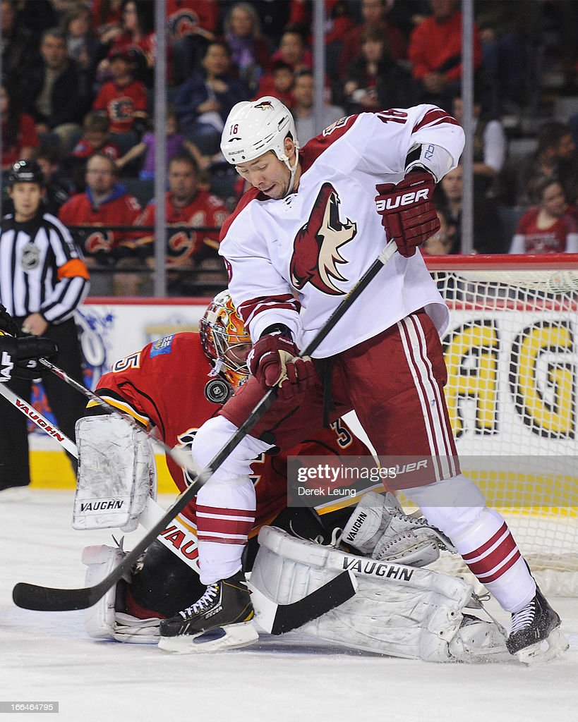 David Moss #18 of the Phoenix Coyotes tries to redirect the loose puck against goalie <a gi-track='captionPersonalityLinkClicked' href=/galleries/search?phrase=Joey+MacDonald&family=editorial&specificpeople=2234367 ng-click='$event.stopPropagation()'>Joey MacDonald</a> #35 of the Calgary Flames during an NHL game at Scotiabank Saddledome on April 12, 2013 in Calgary, Alberta, Canada.
