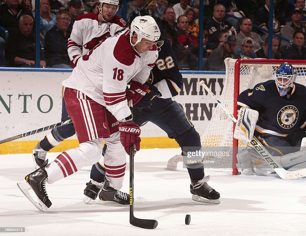 David Moss #18 of the Phoenix Coyotes tries to shoot the puck past Kevin Shattenkirk #22 of the St. Louis Blues in an NHL game on April 18, 2013 at Scottrade Center in St. Louis, Missouri.