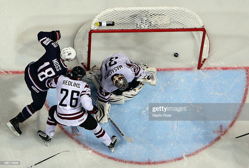 David Moss (#18) of USA scores his team's 2nd goal during the IIHF World Championship group H match between Latvia and USA at Hartwall Areena on May 5, 2013 in Helsinki, Finland.