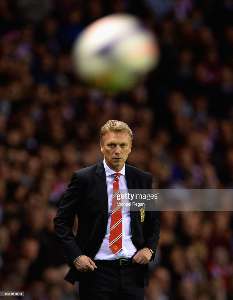 David Moyes, manager of Manchester United keeps his eye on the ball during the Barclays Premier League match between Sunderland and Manchester United at the Stadium of Light on October 5, 2013 in Sunderland, England.