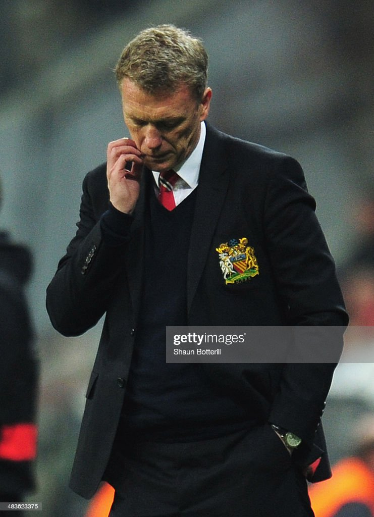 <a gi-track='captionPersonalityLinkClicked' href=/galleries/search?phrase=David+Moyes&family=editorial&specificpeople=215482 ng-click='$event.stopPropagation()'>David Moyes</a>, manager of Manchester United looks dejected during the UEFA Champions League Quarter Final second leg match between FC Bayern Muenchen and Manchester United at Allianz Arena on April 9, 2014 in Munich, Germany.