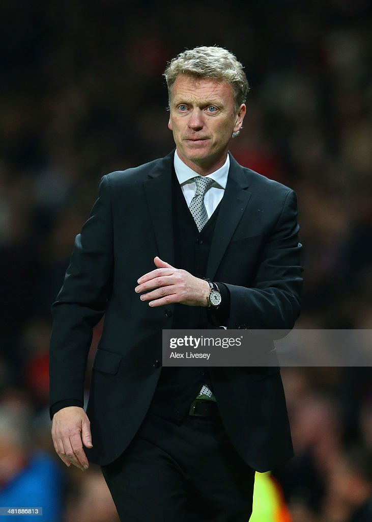 David Moyes manager of Manchester United looks on during the UEFA Champions League Quarter Final first leg match between Manchester United and FC Bayern Muenchen at Old Trafford on April 1, 2014 in Manchester, England.