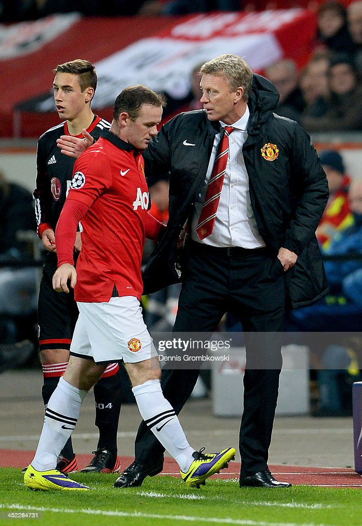 David Moyes manager of Manchester United pats Wayne Rooney of Manchester United on the back as he makes his way to the bench during the UEFA Champions League Group A match between Bayer Leverkusen and Manchester United at BayArena on November 27, 2013 in Leverkusen, Germany.