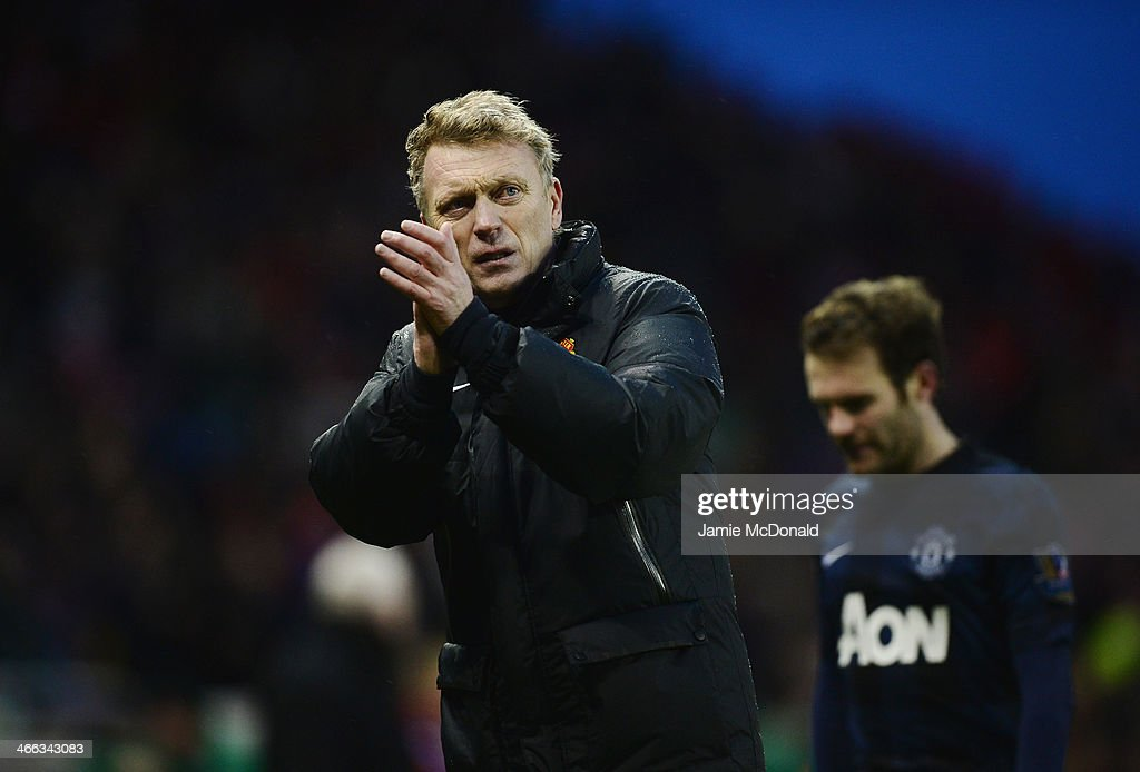 David Moyes, manager of Manchester United walks off with Juan Mata after the Barclays Premier League match between Stoke City and Manchester United at Britannia Stadium on February 1, 2014 in Stoke on Trent, England.