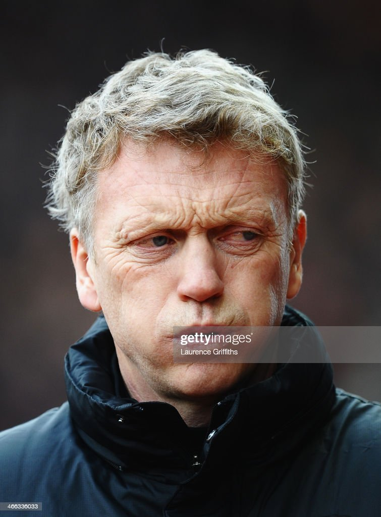 David Moyes, manager of Manchester United walks out for the Barclays Premier League match between Stoke City and Manchester United at Britannia Stadium on February 1, 2014 in Stoke on Trent, England.