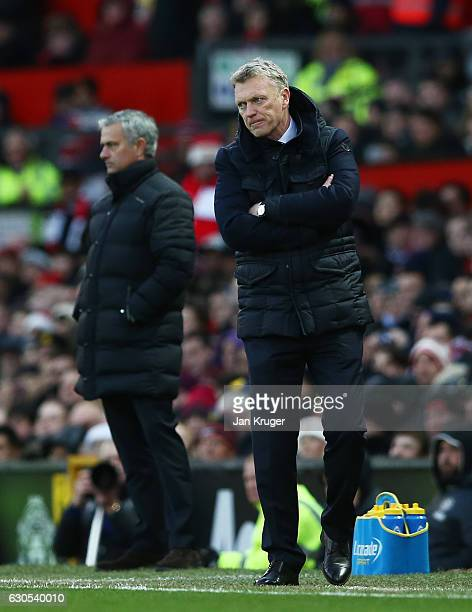 David Moyes Manager of Sunderland and Jose Mourinho Manager of Manchester United look on during the Premier League match between Manchester United...
