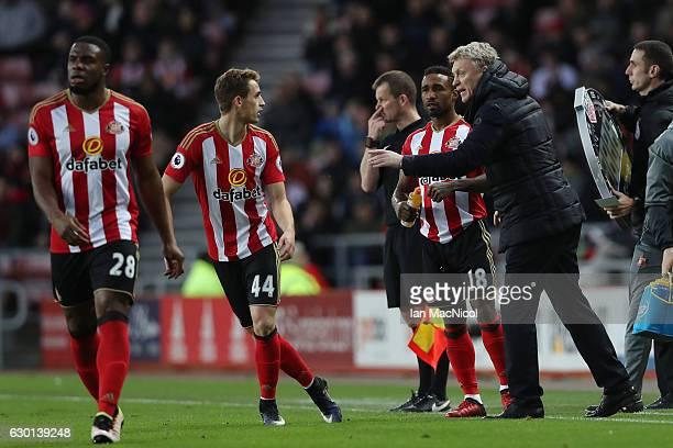 David Moyes Manager of Sunderland speaks to Adnan Januzaj of Sunderland during the Premier League match between Sunderland and Watford at Stadium of...