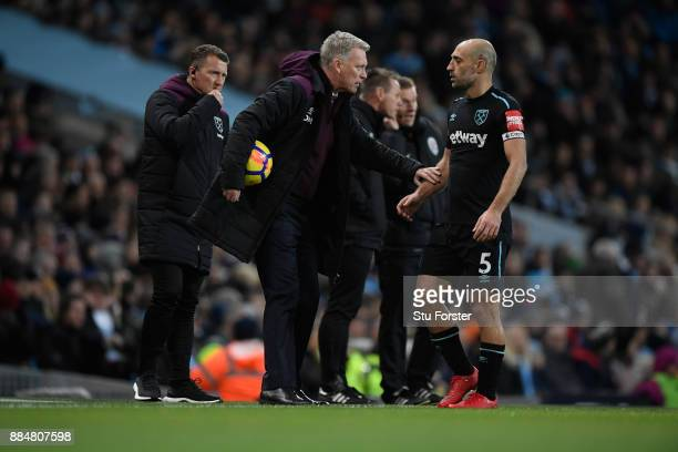 David Moyes Manager of West Ham United and Pablo Zabaleta of West Ham United speak during the Premier League match between Manchester City and West...