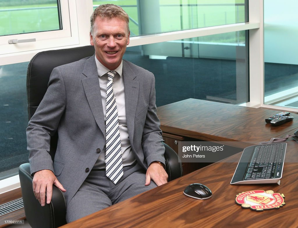 <a gi-track='captionPersonalityLinkClicked' href=/galleries/search?phrase=David+Moyes&family=editorial&specificpeople=215482 ng-click='$event.stopPropagation()'>David Moyes</a> of Manchester United, arrives for his first day of work as the club's new manager at Carrington Training Ground on July 1, 2013 in Manchester, England.