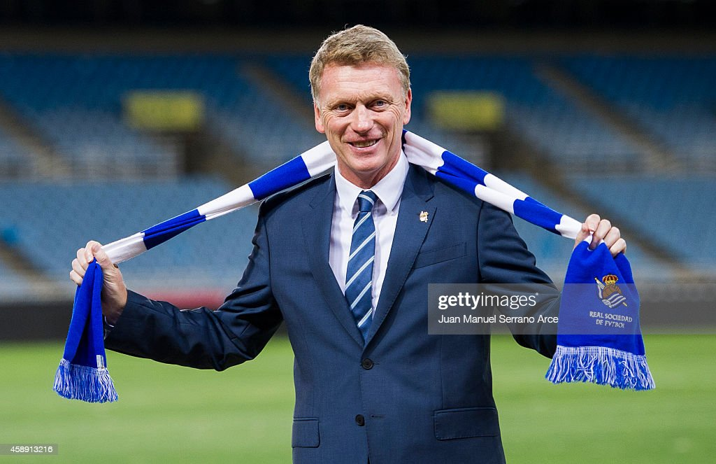 <a gi-track='captionPersonalityLinkClicked' href=/galleries/search?phrase=David+Moyes&family=editorial&specificpeople=215482 ng-click='$event.stopPropagation()'>David Moyes</a> poses with a scarf during presented as Real Sociedad's new head coach at Estadio Anoeta on November 13, 2014 in San Sebastian, Spain.